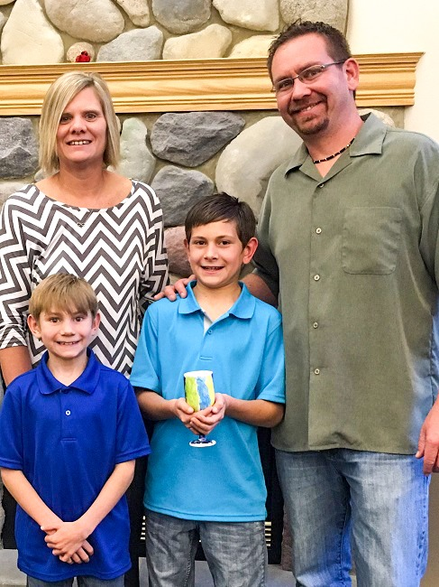 Jason and Jody Bell, with their two sons, Parker and Konner.