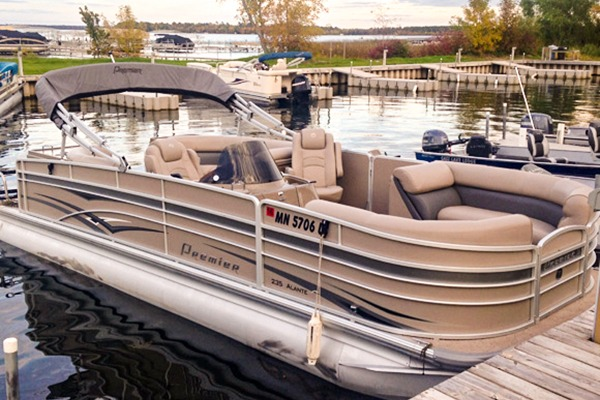 Beautiful tan and blue Premier Pontoon that can be rented at Cass Lake Lodge.